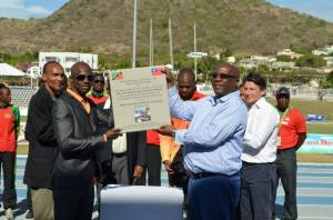 SKNAAA President Glen Jeffers at first right during recent renaming ceremony of Kim Collins Stadium with Kim Collins and SKN Prime MINISTER Dr. Timothy Harris