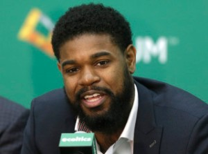 Boston Celtics player Amir Johnson speaks during a news conference at the NBA basketball team's training facility Monday, July 27, 2015, in Waltham, Mass. The news conference was held to introduce five Boston Celtics players including Johnson. (AP Photo/Steven Senne)