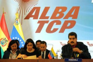 The president of the Bolivarian Republic of Venezuela , Nicolas Maduro ( D ) , intervenes during the closing of the IV Extraordinary Meeting of the Political Council of ALBA Trade Treaty of the Peoples ( TCP Alba ) , which takes place on the premises of the Yellow House in Caracas on August 10 , 2015. AIN PHOTO / Omara Garcia MEDEROS