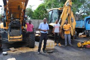 PEP trainees have been given the opportunity to work on heavy equipment. Here they take a break from working on a backhoe to pose for a picture. From left: Mr Michel Nicholas, Foreman Mr Valentine Fraites, Mr Jared Bedminister, and Grade One Mechanic Mr Eric Monzac