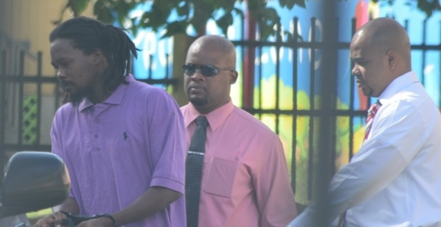 Andraes Norford being escorted by RVIPF officers at the magistrate court, November 23, 2015