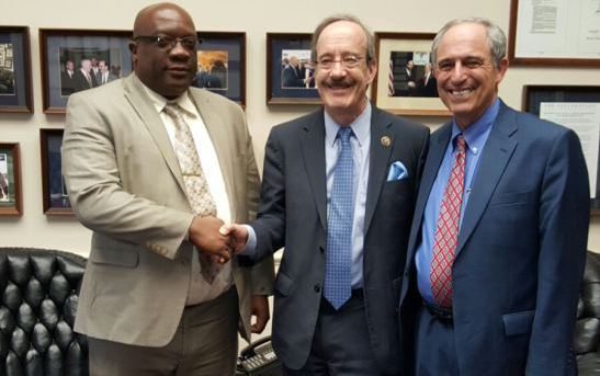 Prime Minister Harris with Lanny Davis, EVP, LEVICK, former White House special counsel, and US Congressman Eliot Engel